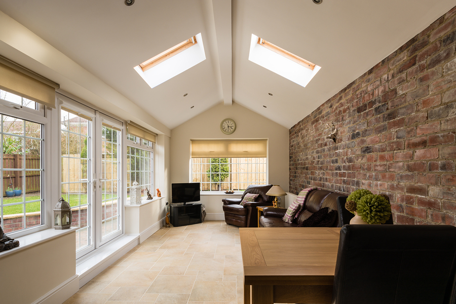Attractive Modern Sunroom Or Conservatory Extending Into The Garden With A Featured  Brick Wall