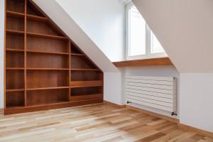 View of empty bookshelf in the attic